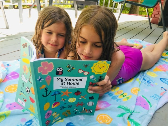 Kids writing in summer journal