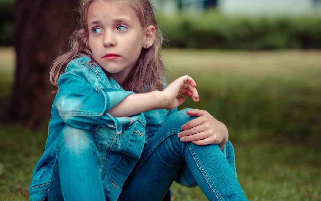 girl sitting near try feeling lost